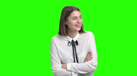 dobra : Portrtrait of cute girl laughing with teeth. Smiling young woman. Green screen hromakey background for keying.