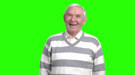 ha : Front view grandpa laughing out loud. Cheerful granddad happily laughing in green hromakey background.