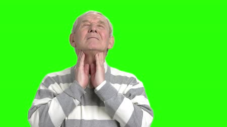 endure : Grandpa having pain in his neck. Old man massage his neck, green hromakey background. Stock Footage