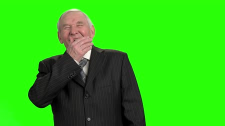 energized : Senior politician laugh out loud, slow-motion. Old rich businessman chortling against green hromakey background. Stock Footage