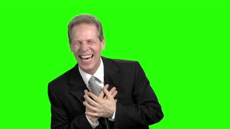 overwrought : Extremely happy politician won elections. Touching chest with both hands. Green screen hromakey background for keying. Stock Footage