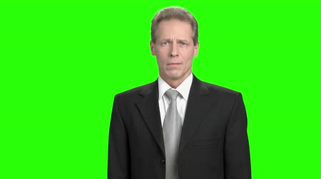 bewilderment : Mature businessman exrtremely dissapoint. Man lost money bacause of gambling. Angry nervous businessman in green hromakey background. Stock Footage