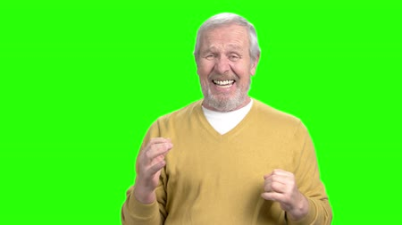 вырезка : Desperate elderly man gesturing with hands. Stressed and depressed old man on chroma key background. Human facial expressions. Стоковые видеозаписи