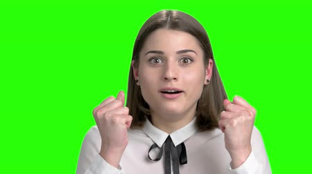 extremely : Extremely shocked surprised young woman portrait. Green screen hromakey background for keying.
