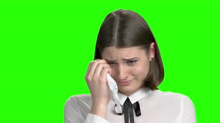 zsebkendő : Close up portrait of crying teen student girl. Green screen hromakey background for keying.