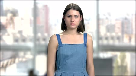 disappointment : Young pretty girl looking serious. Portrait of beautiful girl with dark short hair looking upset. Sad face of attractive woman. Stock Footage