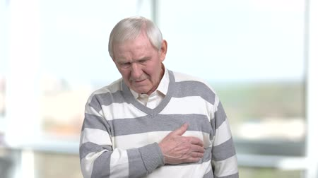 coronary : Senior person having heart-attack. Old man with severe pain in chest. Symptoms of myocardial infarction. Stock Footage