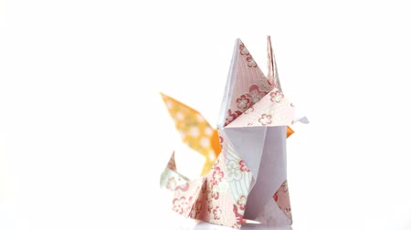 heykelcik : Two cute origami foxes. Colorful animals made from paper. Creative paper figurines. Stok Video