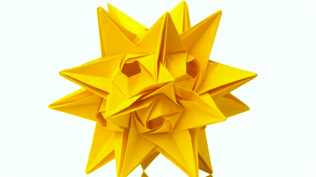 spiky : Spiky origami model of yellow color. Yellow star origami figurine isolated on white background. Japanese paper craft.