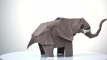 white elephant : Traditional origami elephant from brown paper. Paper animal decoration. Made by kid.