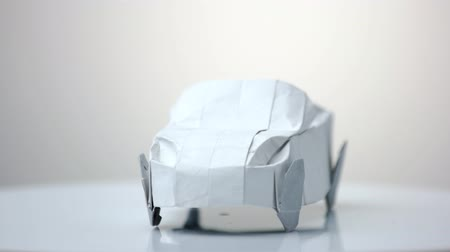 kabriolet : White origami car model. Automobile figurine made of folded paper. Exhibition of paper decorations.