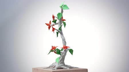 craftsmanship : Beautiful origami bonsai. Decorative paper tree with leaves and flowers. Beauty of japanese art. Stock Footage