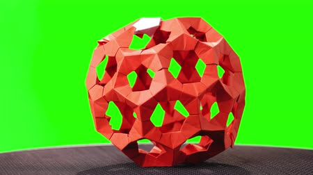 折り紙 : Red modular origami ball on green screen. Beautiful object of paper art on chroma key background. Japanese paper handicraft.