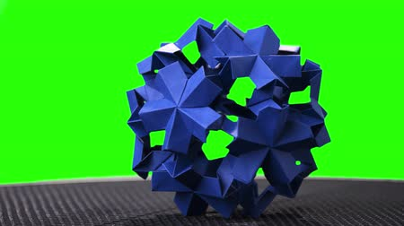折り紙 : Origami flower ball on green screen. Spherical modular origami figurine on chroma key background. Handicraft and paper art.