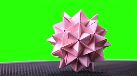 spiky : Pink origami spiky ball. Spiked origami model on chroma key background. Beautiful element of decor. Stock Footage