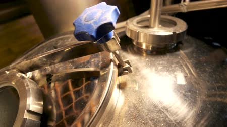 distillation tank : Close up metal brewery equipment. Metal brewery vessel details, close up. Stock Footage