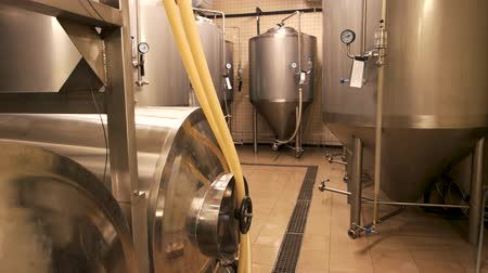 fermenting : Small brewery, craft beer production. Beer tanks, brewery tanks in brewery storage. Stock Footage