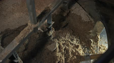 jumble : Brewery waste removing from tank. Worker throwing out brewery waste using shovel, top view. Stock Footage