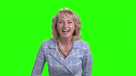 sostituzione : Slow motion mature woman is laughing. Middle aged female executive is laughing on chroma key background. Human expressions of joy. Filmati Stock