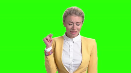 вырезка : Pretty woman is singing on chroma key background. Young elegant girl is singing and gesturing with hands on Alpha Channel background.