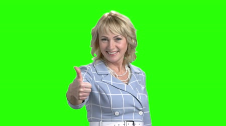 okey : Pretty mature woman showing thumb up. Happy blonde woman giving thumb up sign on chroma key background. Symbol of success. Stock Footage