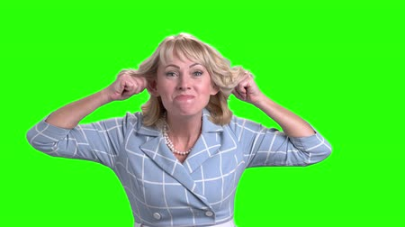 вырезка : Attractive mature business woman making grimace. Middle-aged woman making funny face on chroma key background. Emotions and facial expressions concept.
