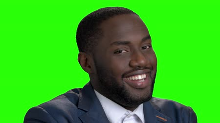 sostituzione : Happy flirting afro american businessman. Close up smiling afro american executive on chroma key background.
