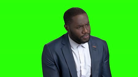 darkskinned : Afro-american business trainer on green screen. Confident afro-american speaker at business conference, Alpha Channel background.