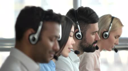 dispatcher : Bearded man working in service center. Caucasian call center worker with beard amoung colleagues. Stock Footage