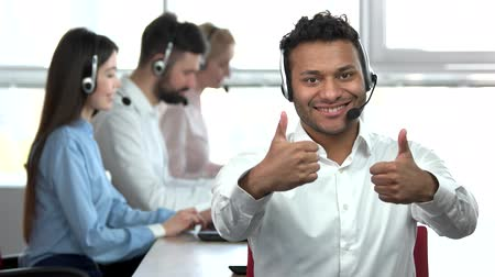 confirmed : Thumbs up and ok gestures by indian call center worker. Two ok gestures, two thumbs up, huge windows background. Stock Footage