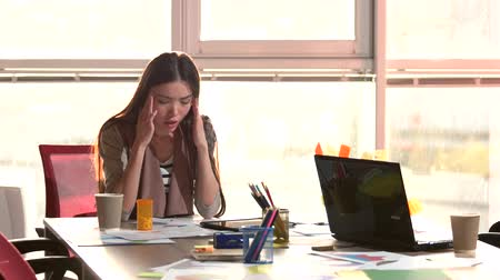 took : Female office worker having an headache. Woman took pills to get rid of headache and continue working. Stock Footage