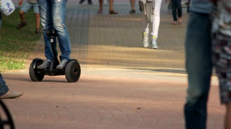 two wheeled : Trendy urban transportation gadget. Man riding gyroscooter, close up.