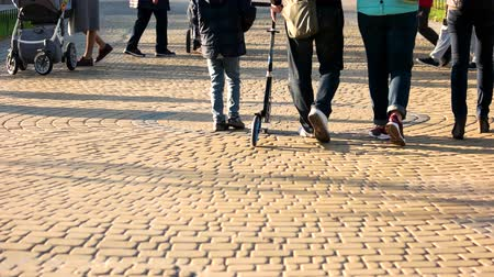 cobbles : 17.09.2017 - Kyiv, Ukraine. Crowd of people walking in the park. Cobblestones surface.