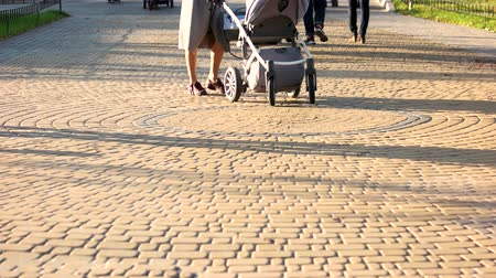 cobbles : 17.09.2017 - Kyiv, Ukraine. Baby carriages in the park. Cobblestones surface. Walking strolling people.