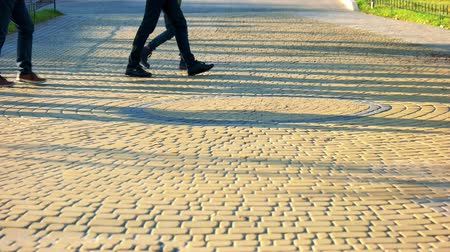 cobbles : Walking people on the cobbles. Cobblestones surface in the park. Stock Footage