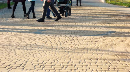 cobbles : 17.09.2017 - Kyiv, Ukraine. People are walking on cobblestone pavement. Sidewalk on the crowded park.