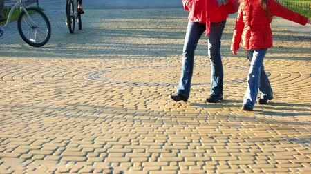 cobbles : People are strolling on cobblestone pavement. Cobblestones surface in the park.