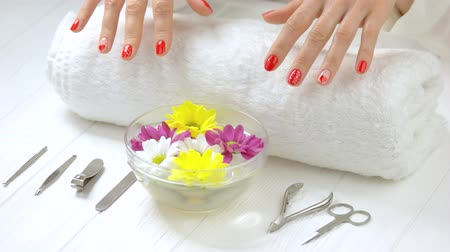 lakier do paznokci : Spa treatment for female hands. Gentle female hands with beautiful romantic manicure receiving spa treatment in beauty salon. Nails and skin salon care.