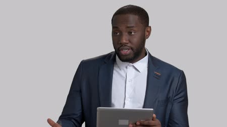 dark skinned : Afro-american manager presenting new project. Confident african american coach in suit with business presentation on pc tablet. Businessman using pc tablet at presentation.