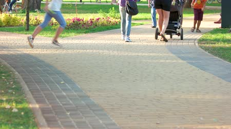 cobbles : Ukraine, Kiev 17.09.2017. People walking in the park on cobbles. Day off holiday in sunny summer day