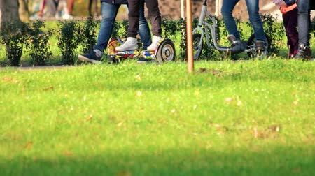 gyroscope : Ukraine, Kiev 17.09.2017. Gyroscooter and kick scooter in the park. Crowdy park, green lawn close up.