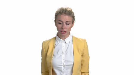 строгий : Angry female manager blaming and accusing. Angry mature woman in yellow business suit. White isolated background.
