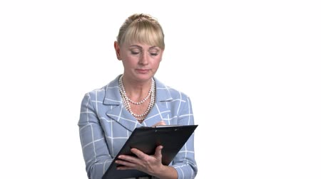 inspector : Mature businesswoman with clipboard and pen. White isolated background.