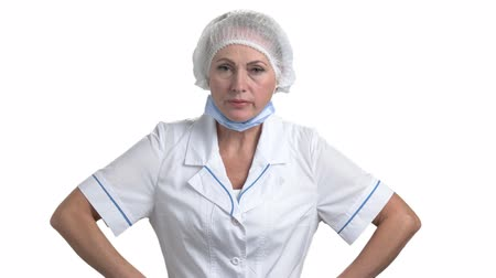 перегружены : Portrait of angry female doctor. Blaming, accusing and punishing. White isolated background.