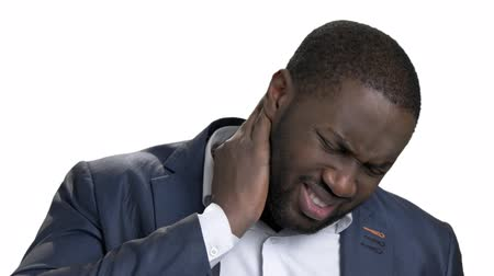 nativo americano : Black african man with bad neck pain, after long hours of work. Isolated white background. Negative human emotions, facial expressions. Vídeos