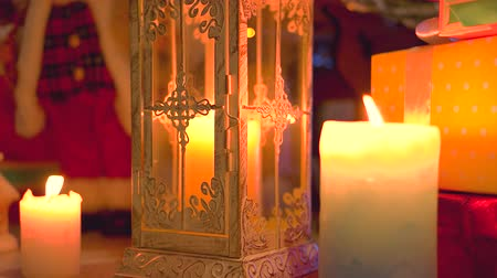santaclaus : Christmas scene with burning candles. Lantern with burning candle. New Year festive composition. Stock Footage
