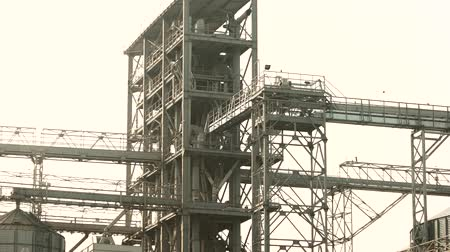хранилище : Plant construction of a large factory. Steel metal construction, white sky background.