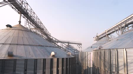 greater : Agricultural silos metal grain facility. Steel grain constructions. Stock Footage