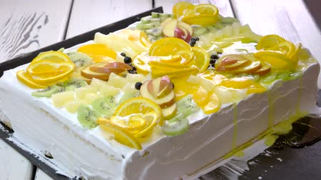 ananas : Cake with fruits and jelly. Preparation of delicious dessert at restaurant. Pastry with yummy cream.
