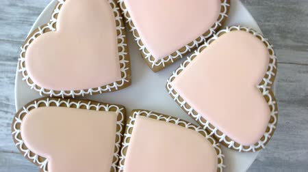 iştah : Heart shaped cookies on plate. Biscuits with light pink glaze. Made with love.